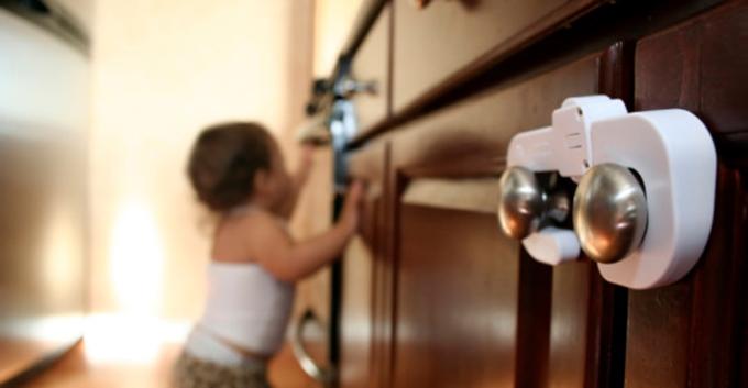 kid looking inside a cabinet